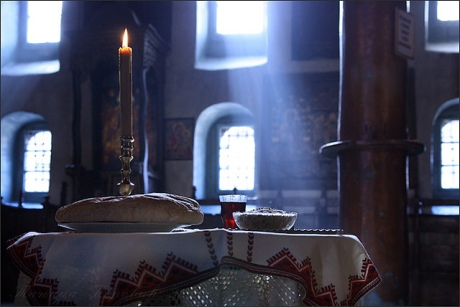 remembering the departed in Orthodox Chrisitian Church - offering bread, boiled wheat and red wine that are blessed by the priest